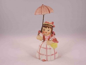 Girl holding umbrella salt and pepper shakers